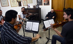 José Antonio Abreu listening to musicians during an interview in Caracas in 2012.