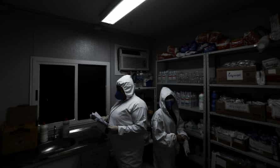 Nurses prepare to attend to Covid patients at Nova Iguacu General Hospital.