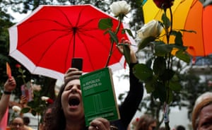A supporter of Brazilian presidential candidate for the Workers Party (PT) Fernando Haddad, holds a Brazilian constitution as she shouts slogans, in Sao Paulo, Brazil during the second round of the presidential election, on October 28, 2018. - Brazilians will choose their president today during the second round of the national elections between the far-right firebrand Jair Bolsonaro and leftist Fernando Haddad (Photo by Miguel SCHINCARIOL / AFP) (Photo credit should read MIGUEL SCHINCARIOL/AFP/Getty Images)