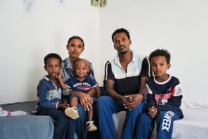 Migrants rescued by Red Cross durring crossing between Libya and Italy. Mineo, Sicily. ITALY Michael Estifannos 28 years old from Eritrea pose for a portrait with his wife and kids.