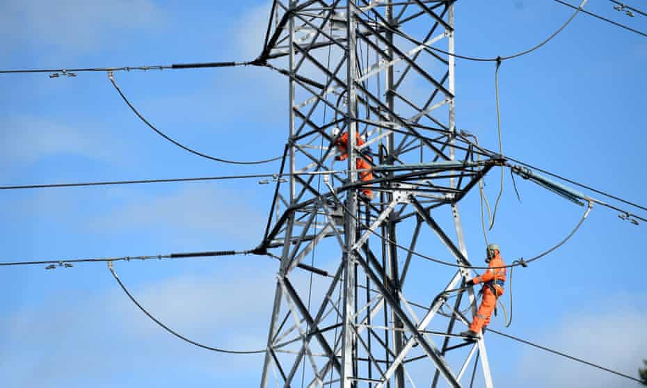 Workers on a high-tension electricty pylon in Sydney