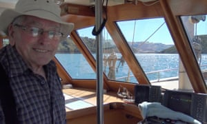 Dick Ledgerwood at the helm of his boat New Zealand.
