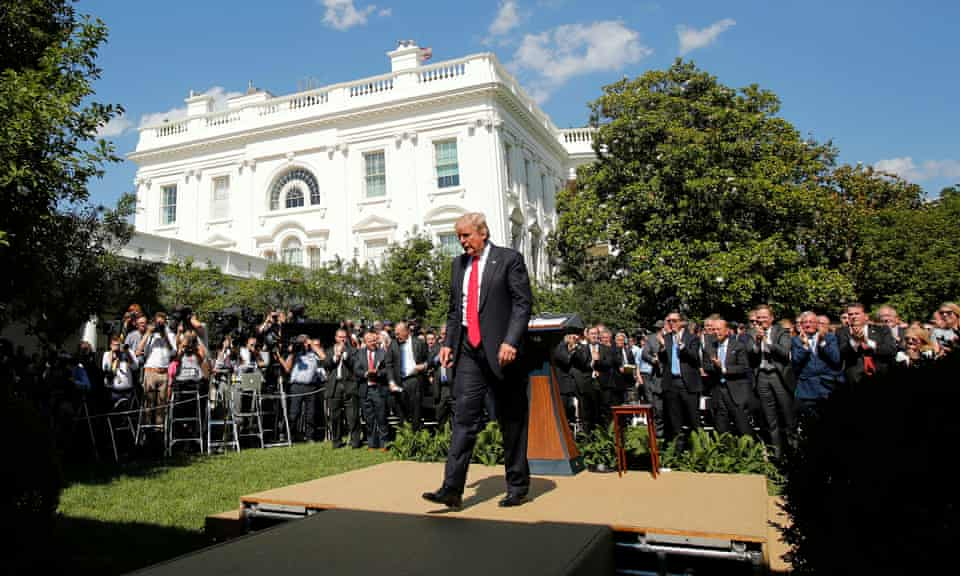 Donald Trump walks away after announcing US withdrawal from the Paris climate agreement, in the Rose Garden of the White House in Washington on 1 June 2017.