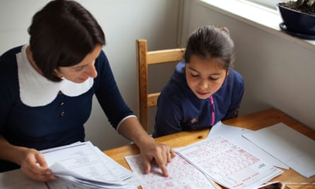 A tutor doing a private lesson with a young child