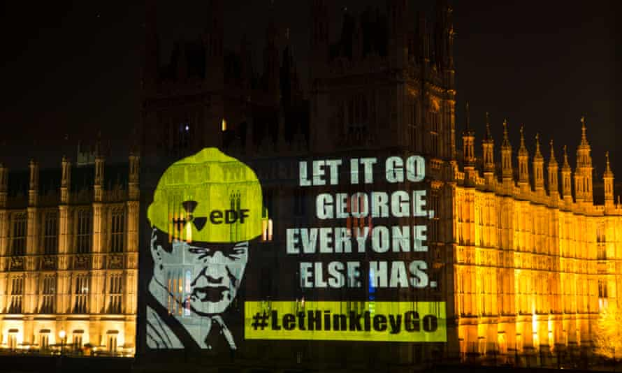 A message to the chancellor, George Osborne, projected by Greenpeace on the Houses of Parliament