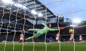 Jack Butland dives but cannot keep Pedro's shot out for Chelsea's third goal.