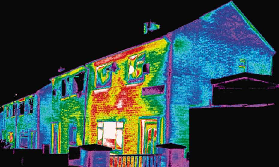A thermal image showing heat loss from a badly insulated house.