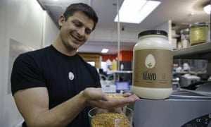 Hampton Creek Foods CEO Josh Tetrick holds a species of yellow pea used to make Just Mayo.