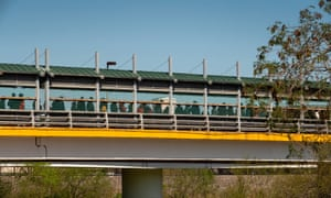 Migrants queue at the Gateway International Bridge in Matamoros, Tamaulipas, Mexico, 28 February 2020.