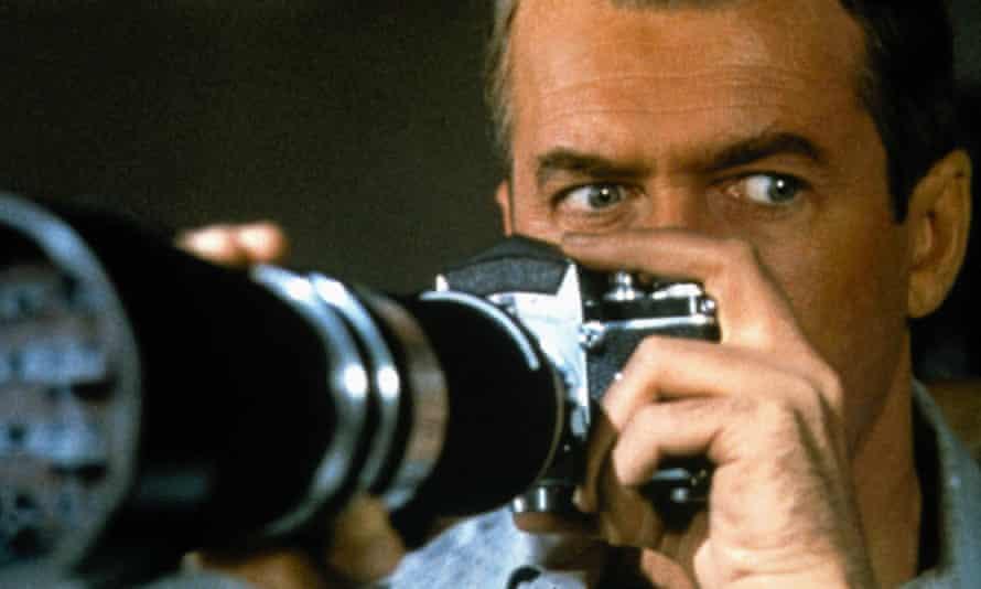 James Stewart keeps watch in Hitchcock's Rear Window.