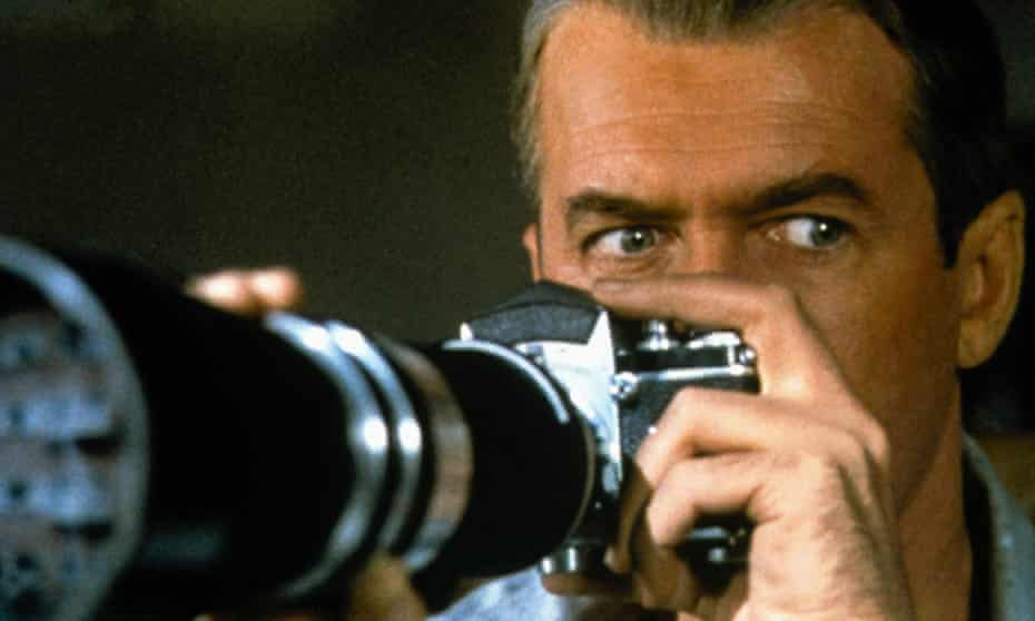James Stewart behind a telescopic camera lens in Rear Window