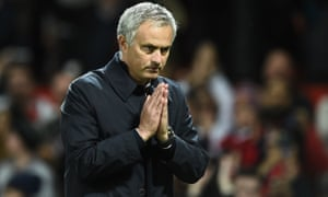José Mourinho gestures to Manchester United fans during the EFL Cup win over Manchester City.