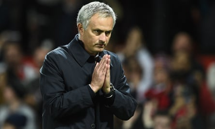 José Mourinho gestures to supporters after the EFL Cup win.