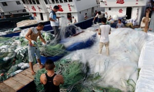 Fishermen arrange nets at the Qingkou port in east China's Jiangsu province.