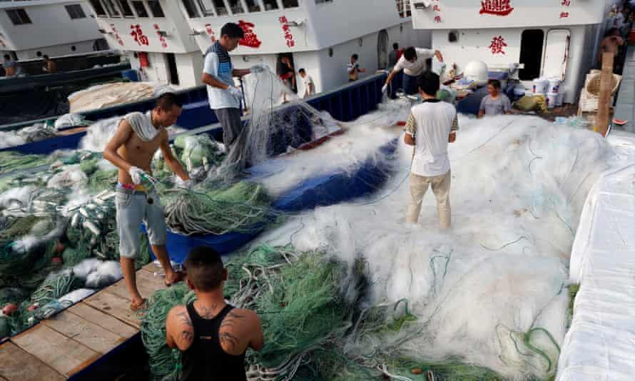 Fishermen arrange nets at the Qingkou port in east China's Jiangsu province.