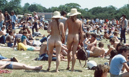 A naked couple in the crowd at the 1969 Woodstock festival