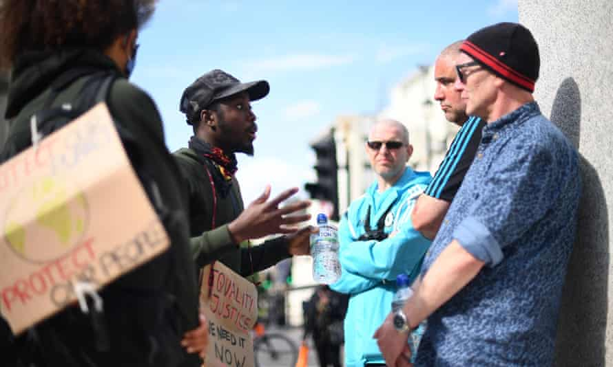 BLM demonstrators arguing with EDL supporters during a rally at the Churchill statue in Parliament Square, London