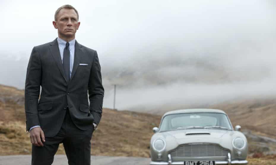 Daniel Craig as Bond, with his Aston Martin DB5, in Skyfall.