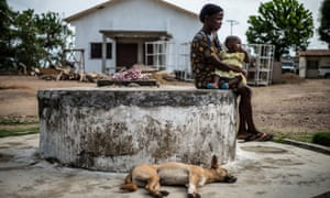 Bendu Alliou sits with her infant daughter outside the hospital in Kailahun, eastern Sierra Leone, 2016. In the wake of the Ebola epidemic, and recovering from a long civil war, Sierra Leone is now confronted with the highest maternal mortality rate in the world with a staggering 3100 maternal deaths per year.