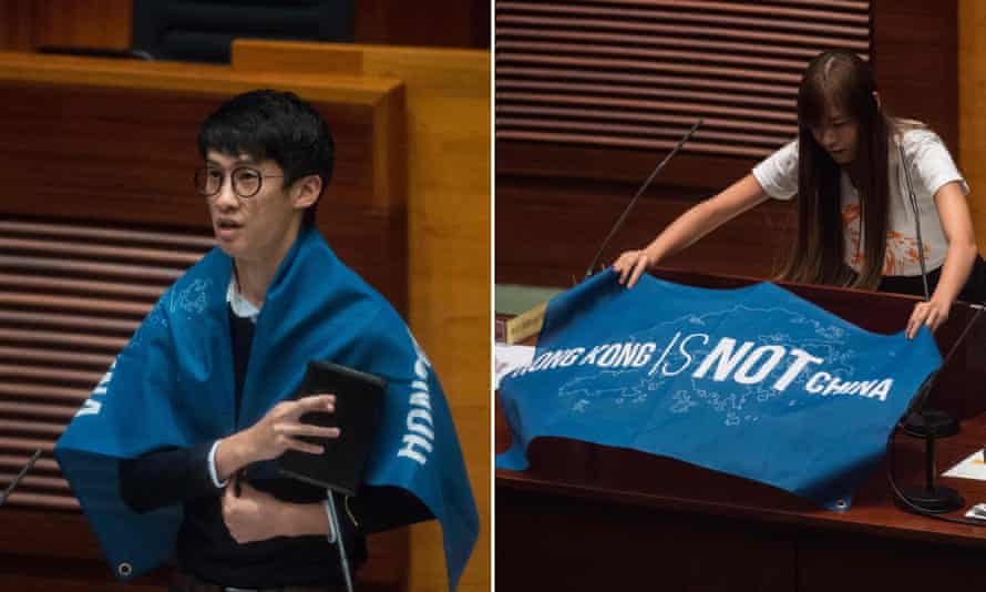 Sixtus 'Baggio' Leung and Yau Wai-ching with anti-China banners during their swearing-in ceremony.
