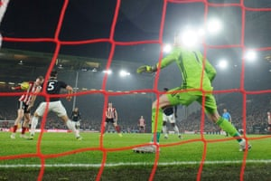 The ball hits Sheffield United's Oliver McBurnie on the shoulder before it drops and is fired into the back of the net to draw the game against Manchester United at Bramall Lane.
