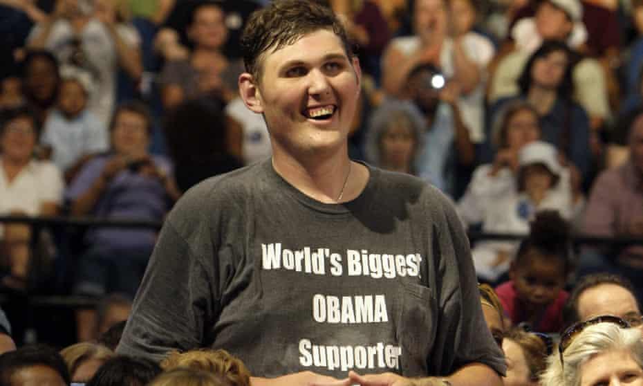 Igor Vovkovinskiy listens to President Barack Obama during a health insurance reform rally in Minneapolis in September 2009.