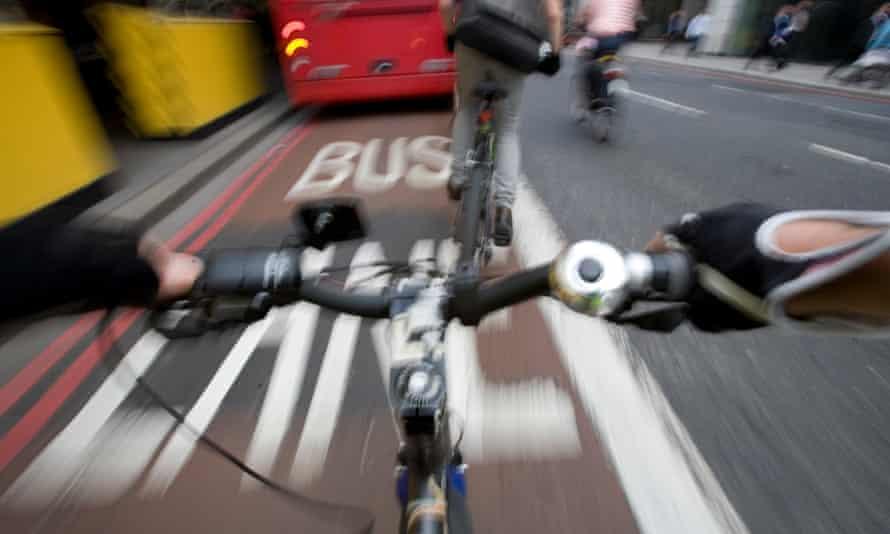 Cycling in traffic in London.