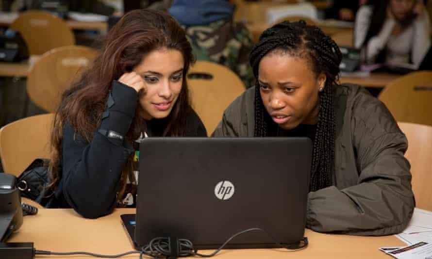 Students look at a computer screen
