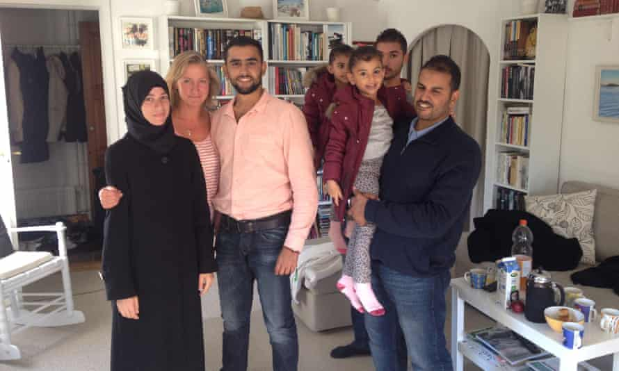 Lisbeth Zornig with a Syrian family she drove to Copenhagen in her car