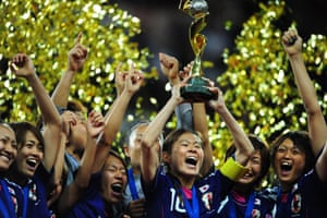 Japan's players celebrate with the trophy after the FIFA Women's Football World Cup final match Japan vs USA on July 17, 2011 in Frankfurt am Main, western Germany. Japan won 3-1 in a penalty shoot-out after the final had finished 2-2 following extra-time. AFP PHOTO / JOHANNES EISELE (Photo credit should read JOHANNES EISELE/AFP/Getty Images)