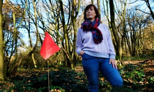 Luci Ryan, lead ecologist with Woodland Trust, with one of the HS2 marker flags that signal the threat to the ancient woodland at Glyn Davies Wood Nature reserve, Banbury.