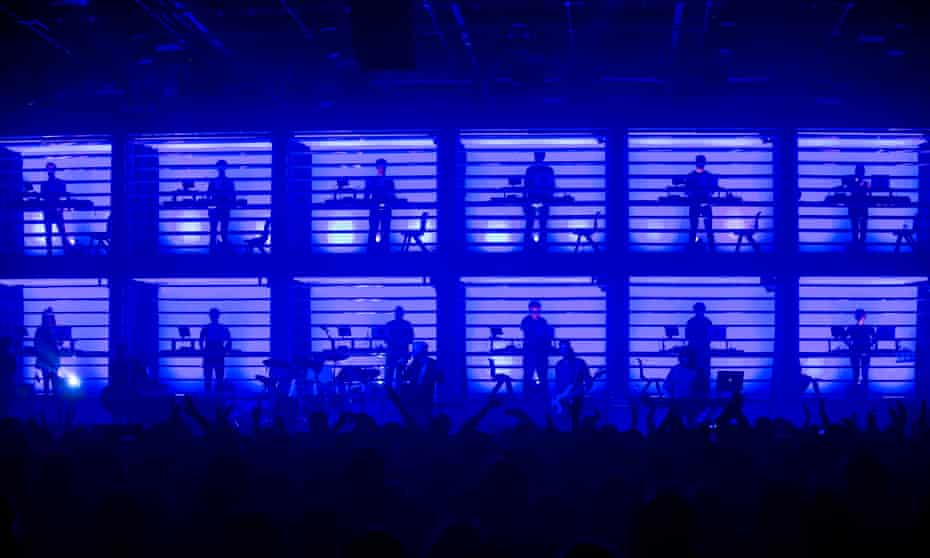 New Order perform with synth orchestra backing at the Manchester international festival.