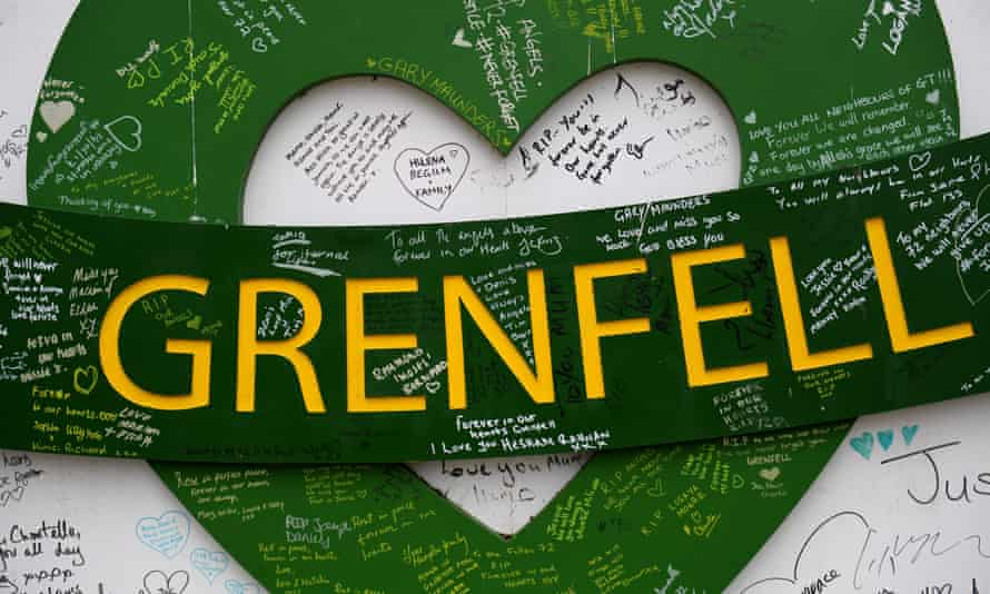 Tributes on hoarding around Grenfell Tower in west London