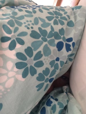 Patterned duvet with a small opening revealing an eye