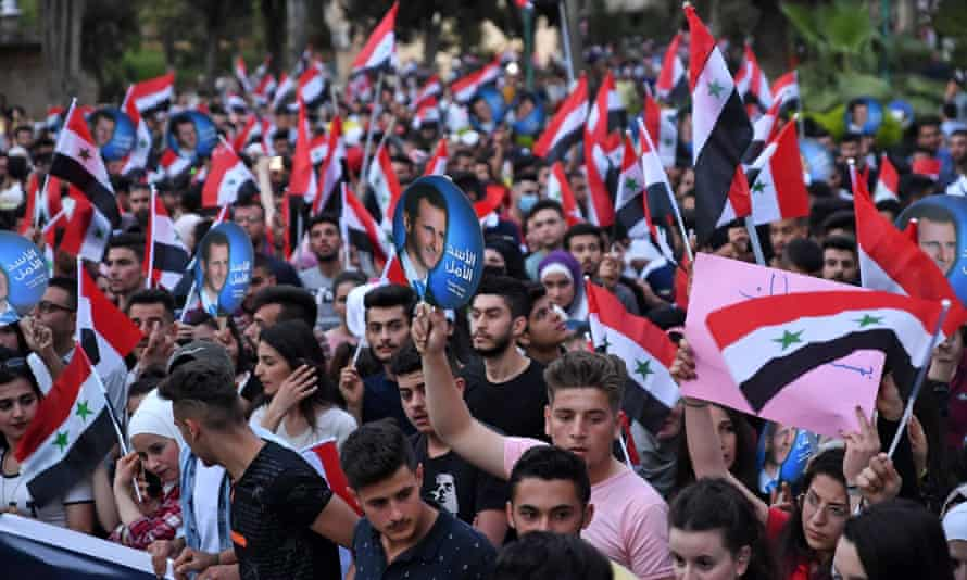 Students march in support of President Bashar al-Assad in Aleppo last week.