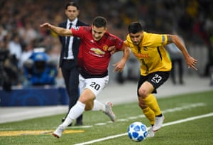 Manchester United's Diogo Dalot, (left) fights for the ball against Young Boys' Loris Benito.