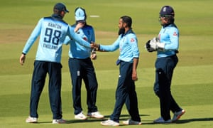 England's Adil Rashid (second right) celebrates taking the wicket of Ireland's Kevin O'Brien.