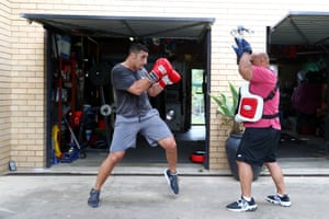 Australian boxer Justis Huni trains at home with his father Rocki on the Gold Coast.
