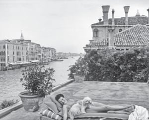 Ice cream and sun … Guggenheim on the roof of her palazzo on Venice's grand canal in the 1950s.