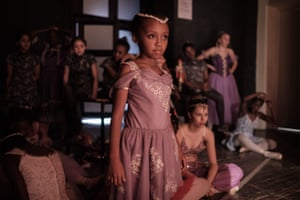 Members of Dance Centre Kenya wait beside the stage during a production of the Nutcracker at the National Theatre in Nairobi, Kenya