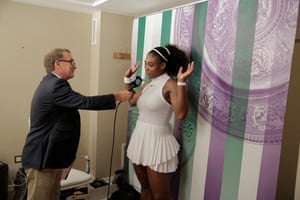 Gary Richardson of the BBC interviewS Serena Williams of the USA immediately she comes off Centre Court after her victory in the women's quarter-final during day eight of the 2016 Wimbledon tennis championships
