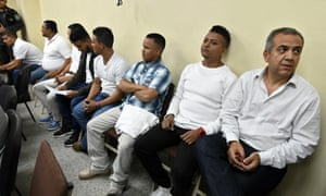 The former manager of Desa Sergio Rodríguez, right, and the seven other people accused of killing the Honduran environmental leader Berta Cáceres, wait to hear their sentence at a courtroom in Tegucigalpa.