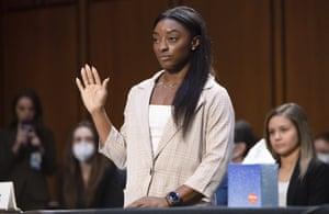 Simone Biles is sworn in.
