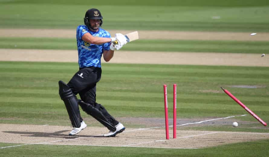 Luke Wright is bowled by Gus Atkinson in the game between Sussex and Surrey at Hove.