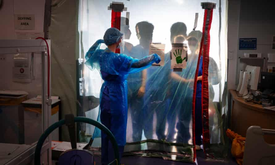Doctors on frontline in fight against Covid-19 prepare ward.