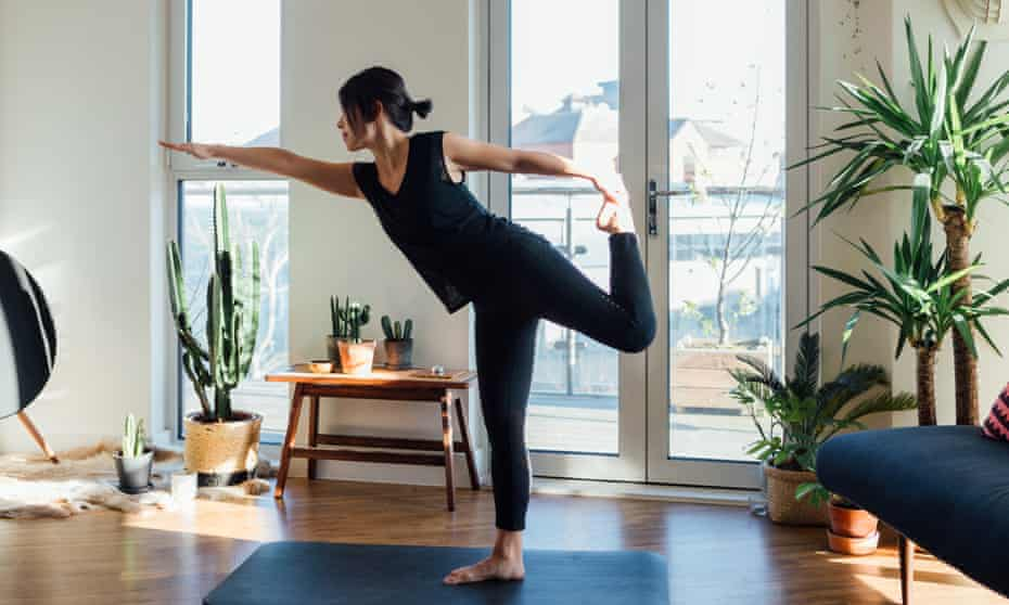 Young woman doing yoga exercise at homeGettyImages-1217598232
