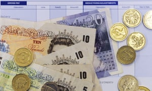 Pound notes and coins on wage slip