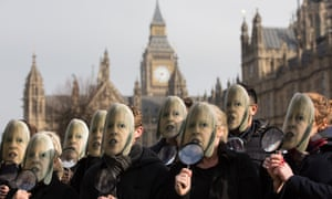 Campaigners protest about Theresa May's 'snooper's charter' outside the House of Commons.