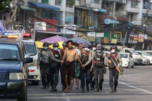 Police arrest a protester in Yangon