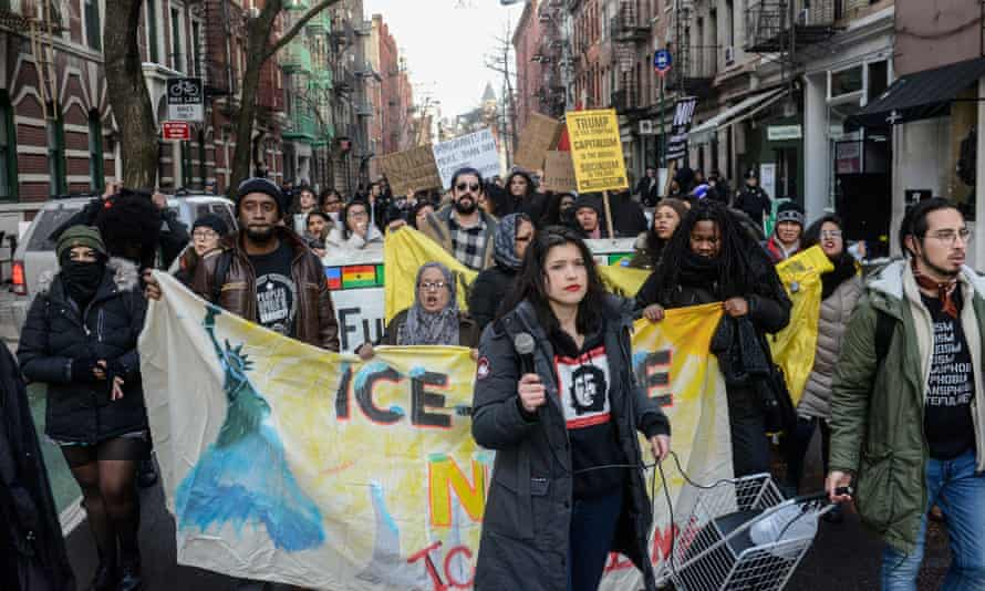 People participate in a protest against Donald Trump's immigration policy and the recent Immigration and Customs Enforcement raids in New York City, on Saturday.